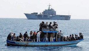 People fleeing the unrest in Tunisia transfer onto the Italian Navy's amphibious transport dock MM San Marco, off the southern Italian island of Lampedusa
